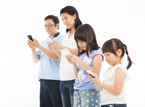 Family using mobile phones